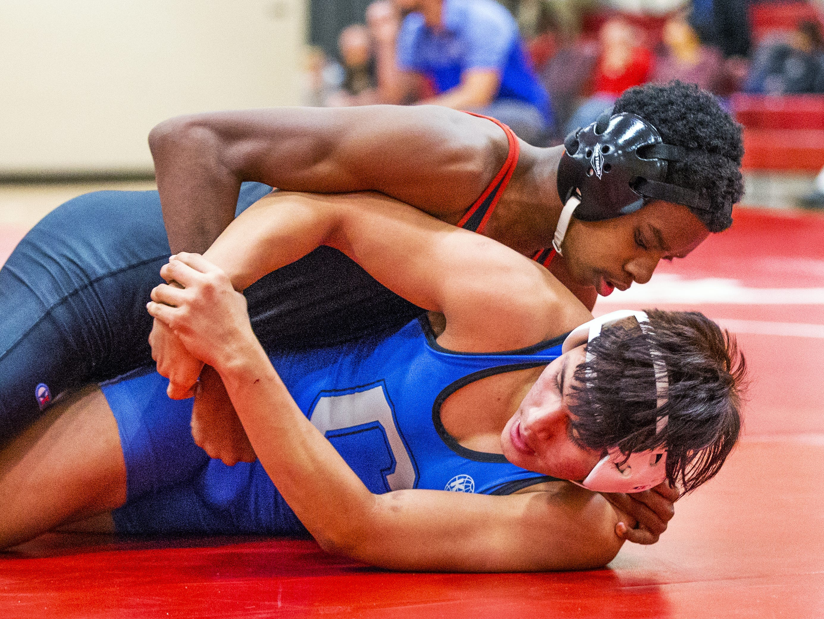 Adonis Watt, on top, is a blind wrestler for Brophy College Preparatory high school in Phoenix.  He takes on Chandler High School wrestler Kevin Rodriguez in the 152 lb. class at Brophy, Wednesday, January 23, 2019.  Watt won with a pin in the third period.