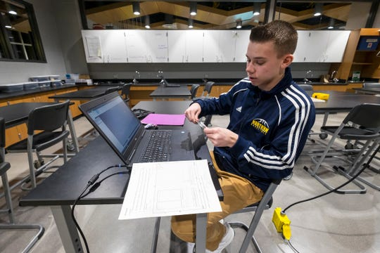 Port Huron Northern junior Austin Meister, 16, talks about using a CAD program to make 3D models of a PlayStation at a ribbon cutting ceremony for the P.J. Wallbank Springs, Inc. Engineering STEAM Lab  Wednesday, Jan. 23, 2019 at Port Huron Northern.