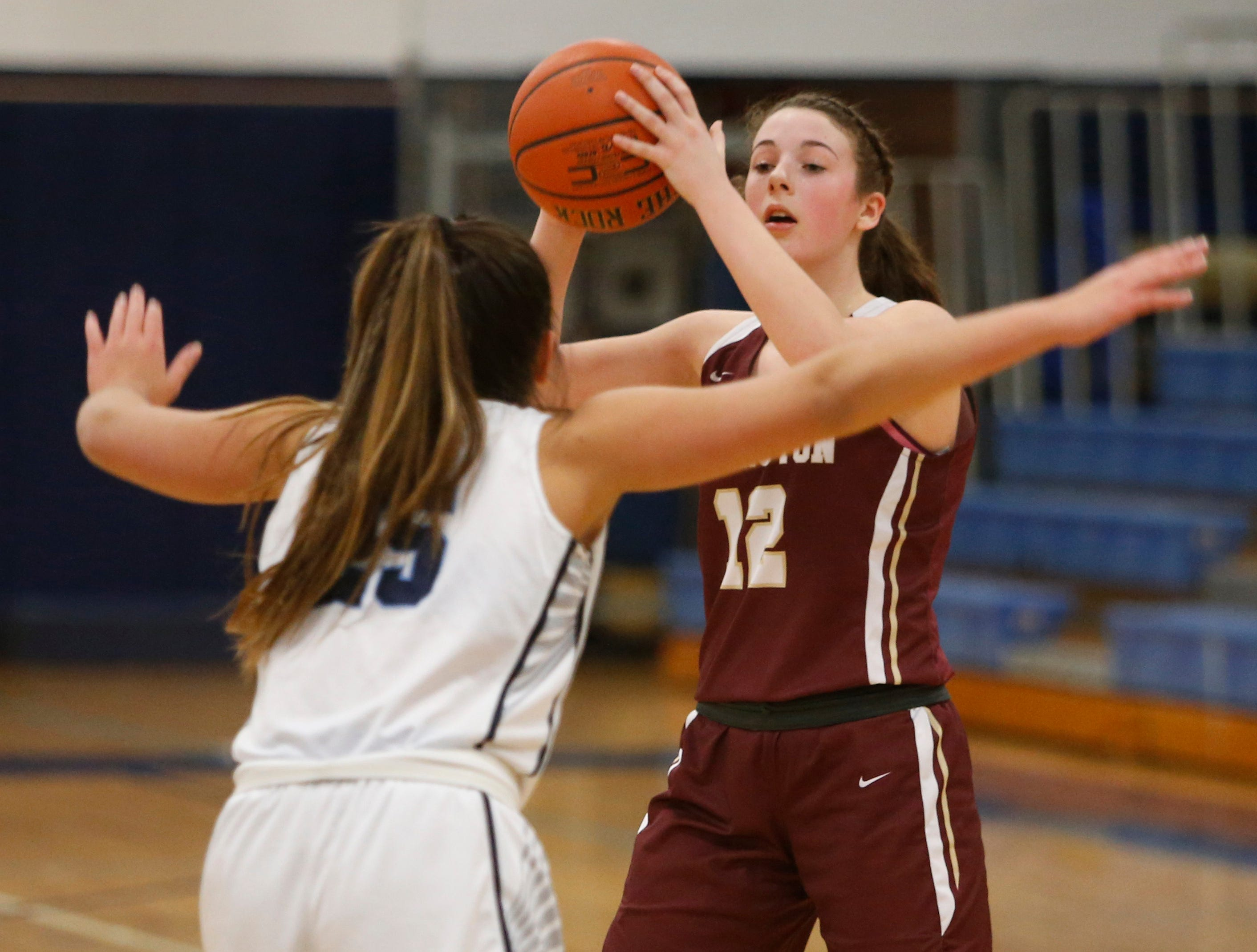Arlington's Molly Stephens is covered by John Jay's Nicole Musacchio during Wednesday's game in Wiccopee on January 23, 2019.