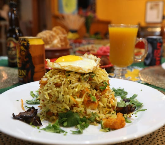 Nasi Goreng rice from the Red Pepper Diner. A fried rice dish with a mixture of seafood and poultry topped with a fried egg.
