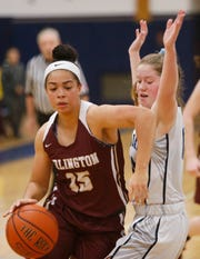 Arlington's Shevaun Judon drives to the net as John Jay's Allison Shaw covers her during a Jan. 23 game.