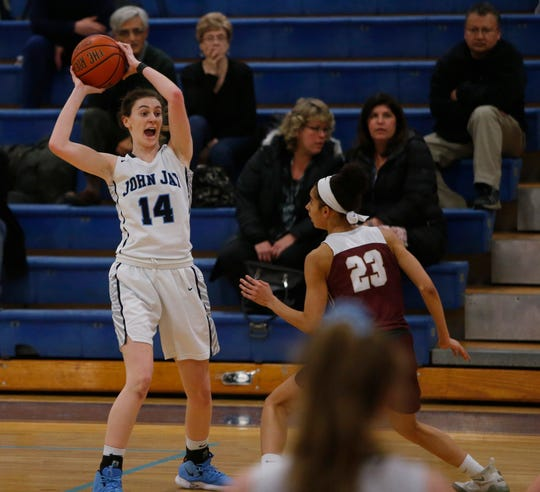 Haley Karst looks to pass to a John Jay High School teammate during a game against Arlington in Wiccopee on Jan. 23.