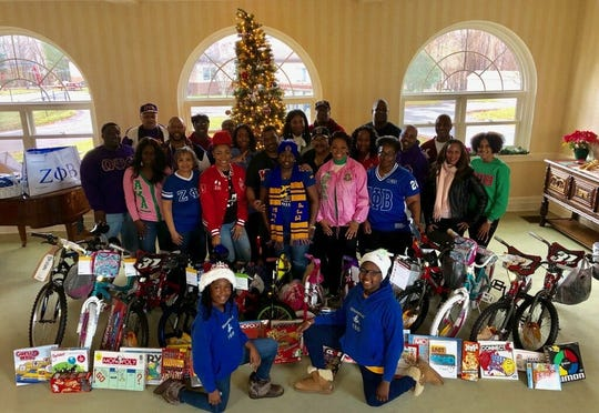 Theta Sigma Sigma Rhosebuds, front row, kneeling, left to right, Tiana Scott and  Jasiah Sinkler are shown with members of the Mid-Hudson Valley National Pan-Hellenic Council during the Dec. 22 event at the Children's Home of Poughkeepsie.