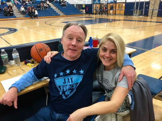 John Jay High School teachers Mike Ambron and Patty Nardone are super fans who help manage the girls basketball team.