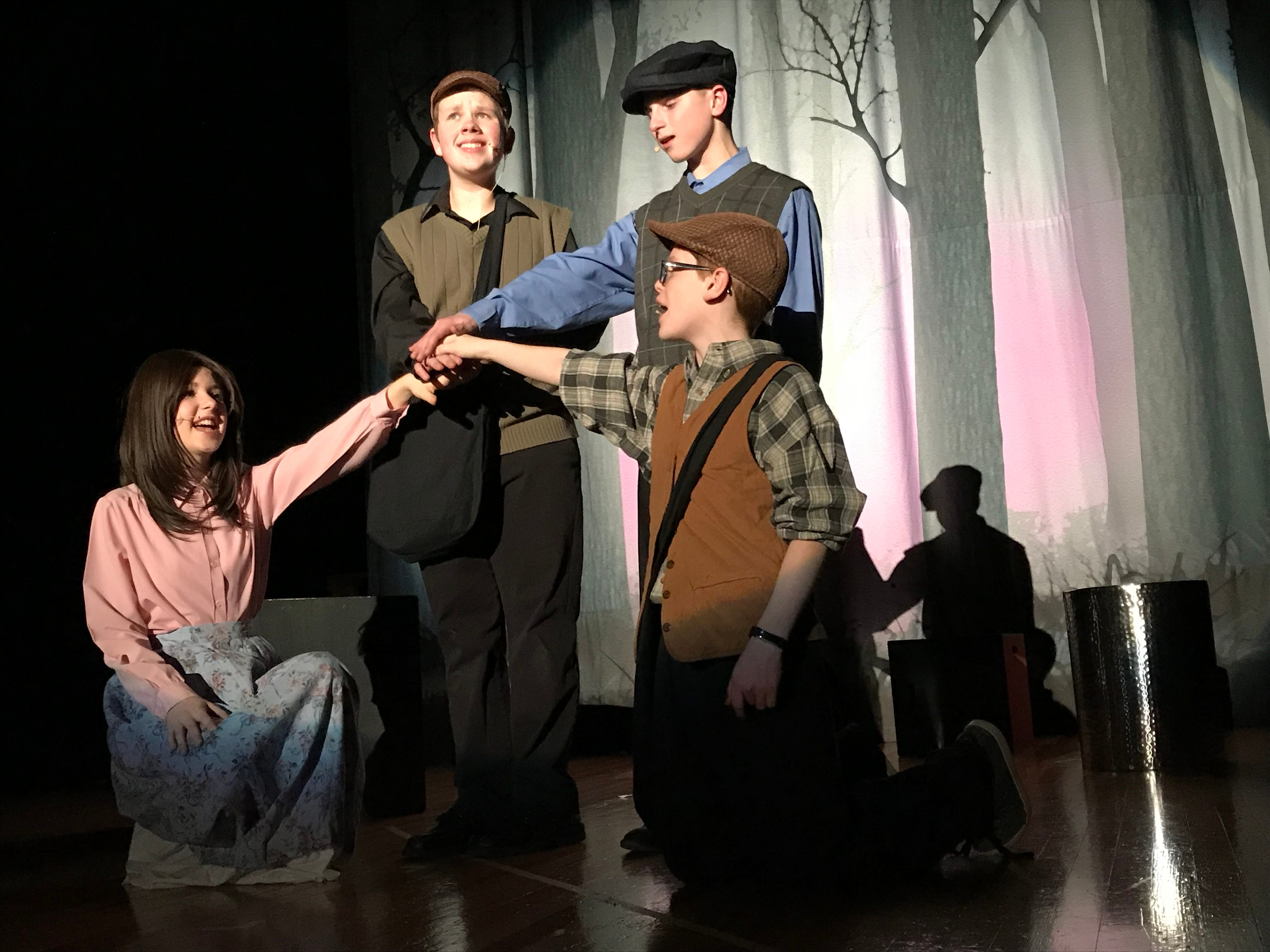 """From left, Madi Ross (as Katherine Plumber), Ryan Wible (as Davey), Nathan Phillips (as Jack Kellyl) and Luke Detweiler (as Les) rehearse a scene for Chambersburg Area Middle School North Drama Club's latest production, """"Newsies,"""" on Wednesday evening, Jan. 24, 2019. Show times are 7:30 p.m. Feb. 1 and 2 in the CAMS North auditorium. For tickets, $8 plus fees, go to showtix4u.com."""