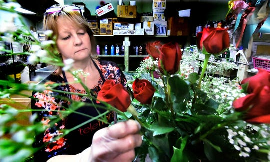 Chas. A. Schaefer Flowers manager Lori Lennox creates an arrangement at the York City flower shop Thursday, Jan. 24, 2019. Chris Sallade, general manager, said he hasn't noticed a slow-down yet, but he is concerned about receiving his flowers late for Valentine's Day if the government shutdown isn't resolved soon. Bill Kalina photo