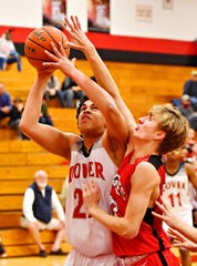 Dover's Elijah Sutton, left, is fouled by Cumberland Valley's Harris Vorwald during boys' basketball action at Dover Area High School in Dover Township, Wednesday, Jan. 23, 2019. Cumberland Valley would win the game 79-46. Dawn J. Sagert photo