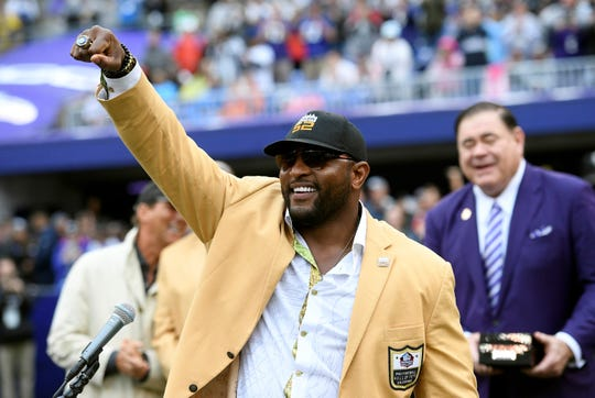 FILE - In this Sept. 23, 2018, file photo, former Baltimore Ravens linebacker Ray Lewis displays his Hall of Fame ring of excellence that he received at a halftime ceremony during an NFL football game between the Ravens and the Denver Broncos, in Baltimore. Lewis is using the celebrity spotlight which will accompany Super Bowl 53 to bring exposure to his Ray of Hope Foundation.  Lewis is throwing a big-ticket party, expected to attract dozens of sports and entertainment stars, to raise money for the foundation. (AP Photo/Nick Wass, File)