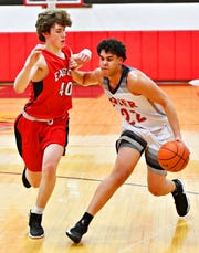 Dover's Elijah Sutton, right, pushes to get past Cumberland Valley's Ben Drury during boys' basketball action at Dover Area High School in Dover Township, Wednesday, Jan. 23, 2019. Cumberland Valley would win the game 79-46. Dawn J. Sagert photo