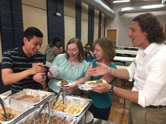 A group shares food during a York Young Professionals event.