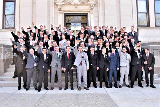 Students at a Wisconsin high school were photographed apparently giving the Nazi salute during a class photo.