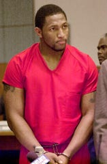 FILE - In this Feb. 1, 2000, file photo, Baltimore Ravens linebacker Ray Lewis listens to the proceedings in Atlanta Municipal Court. The Super Bowl is in Atlanta, just like in 2000 when Lewis and two others were charged in double murders following the St. Louis Rams' win over the Tennessee Titans. Murder and aggravated assault charges against Lewis were dropped when he agreed to plead guilty to obstruction of justice, a misdemeanor. This time Lewis will be using the celebrity spotlight at the Super Bowl in Atlanta to bring exposure to his Ray of Hope Foundation. (AP Photo/Erik S. Lesser, File)