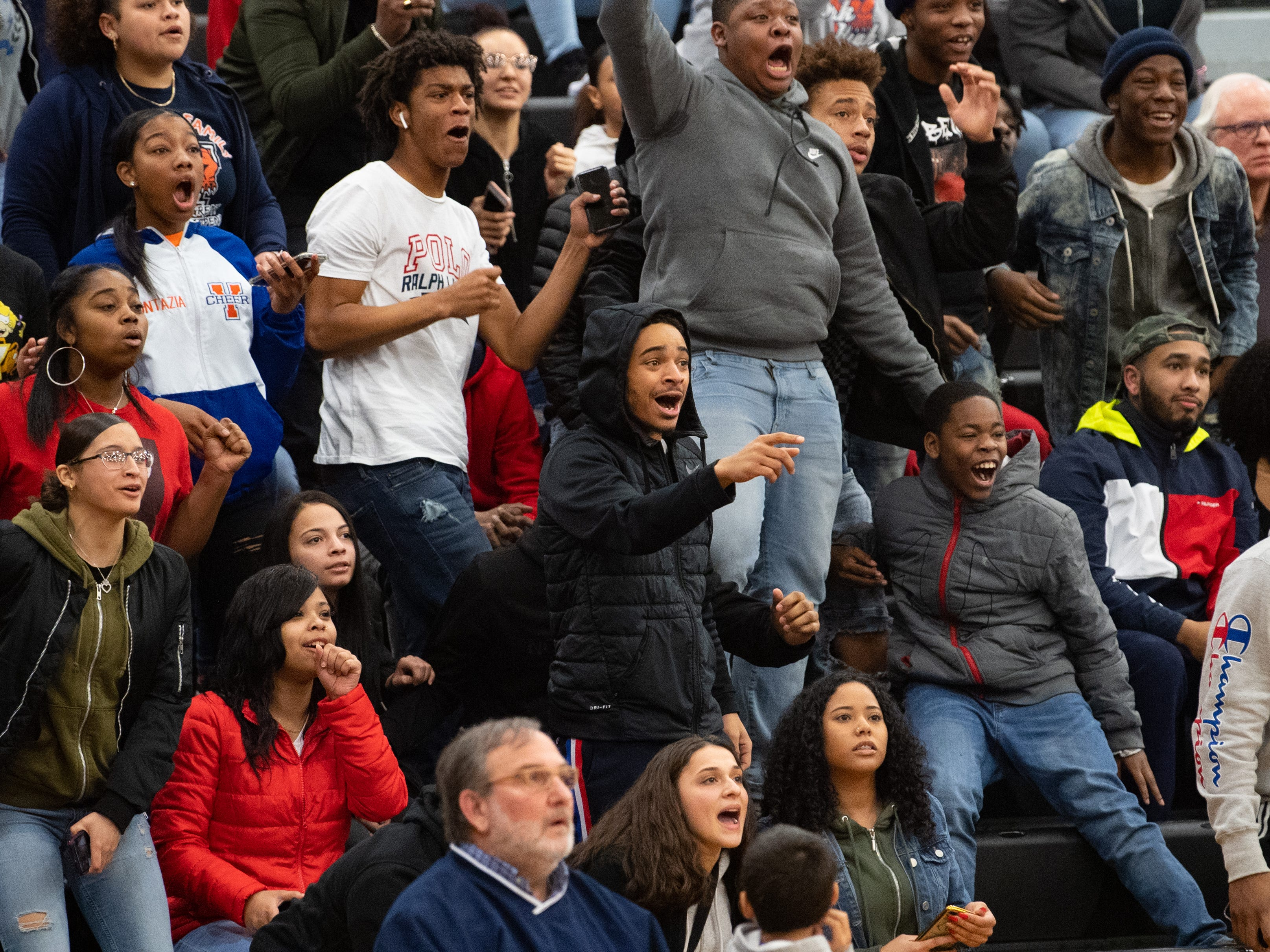 York High fans go crazy after a deep three pointer during the boys' basketball game between Harrisburg High and York High, Wednesday, January 23, 2019 at Harrisburg High School. The Cougars defeated the Bearcats 69-65.