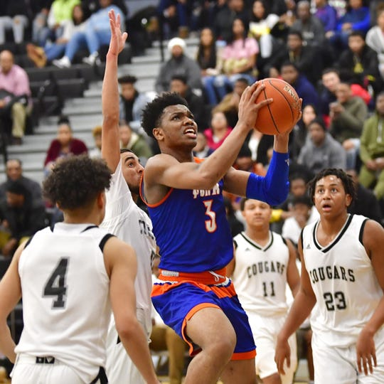 York High senior Clovis Gallon Jr. drives through the paint against Harrisburg on Wednesday, Jan. 23, 2019 at Harrisburg High.