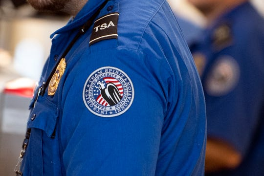 TSA agents remain on the job during the federal government shutdown.