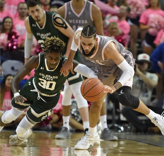 Nevada's Cody Martin beats Colorado State's Kris Martin to a loose ball in the second half of Wednesday's game at Lawlor Events Center.