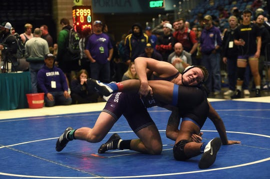 Spanish Springs' Colby Preston, top, defeats Xavier Whitson in a 195-pound consolation match during the Reno Tournament of Champions wrestling event at the Reno Events Center on Dec. 16, 2017.