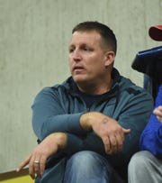 Jon Haskins, Reno's new football coach, watches the Reno boys basketball game at Reed onTuesday.