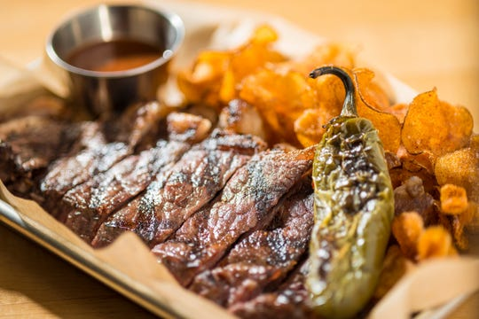 Housemade barbecue chips accompany New York strips and signature ranchero sauce on the gastro fare menu at the Depot Craft Brewery Distillery.