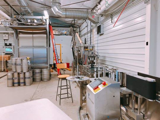 The new 35-foot canning line at the Depot Craft Brewery Distillery can outpout 65 cans of beer per minute.