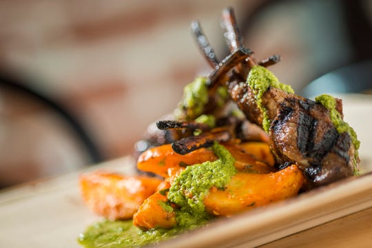 Executive chef Nick Strowmatt's winter menu at the Depot Craft Brewery Distillery includes lamb chops spattered with cilantro-poblano chimichurri.