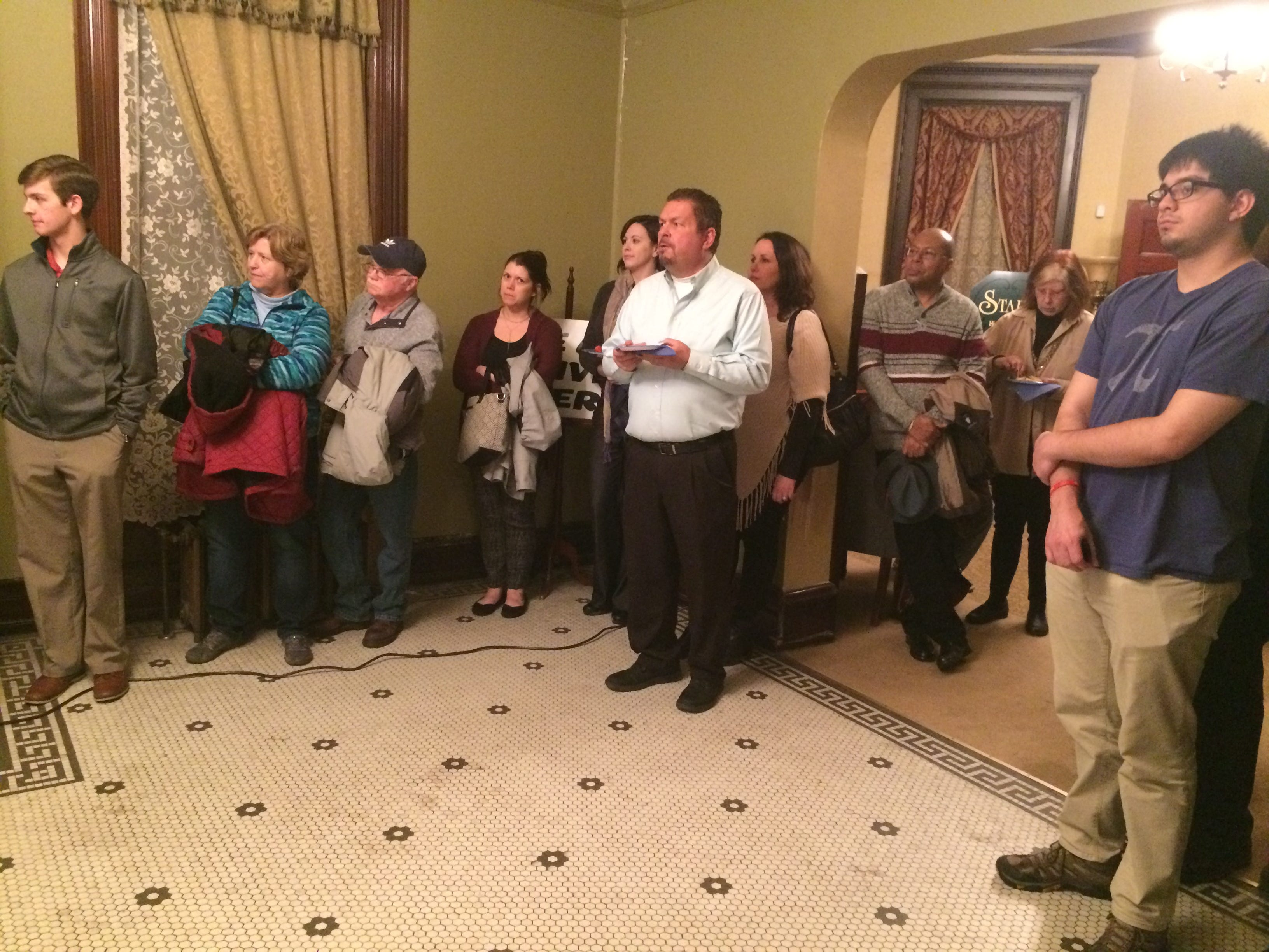 Attendees listen to Jack Cruse during his kickoff event Wednesday night for his mayoral campaign.