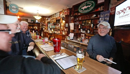 Owner Jim Barnash, far right, shares laughs from behind the bar with longtime regulars Ron Holland, left, Ed Cyrana, center, and Steve Marshall, right, at the Reunion Inn in Irondequoit Thursday, Jan. 24, 2019.