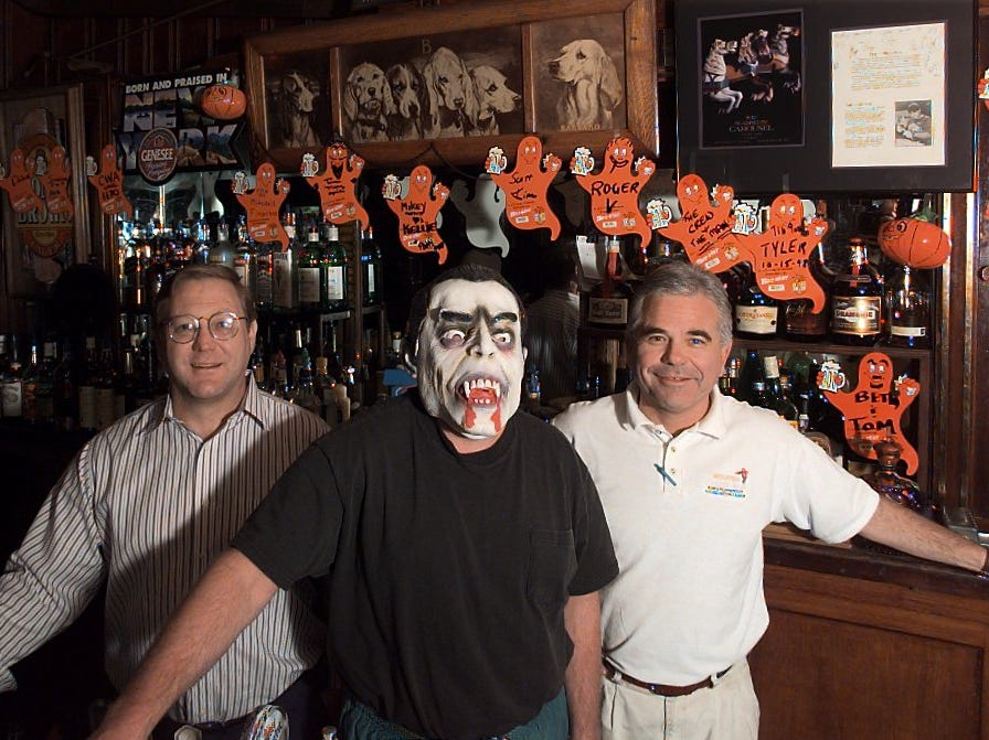 Jimmy Barnash, Steve Sahs (dracula) and Bill Riddle stand behind the bar at Reunion Inn. Steve had an experience with a ghost in the basement years ago. He hasn't seen any signs of the ghosts now but wouldn't spent the night there.