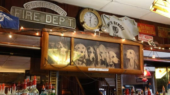 A set of dog portraits hang over the bar at the Reunion Inn in Irondequoit Thursday, Jan. 24, 2019.