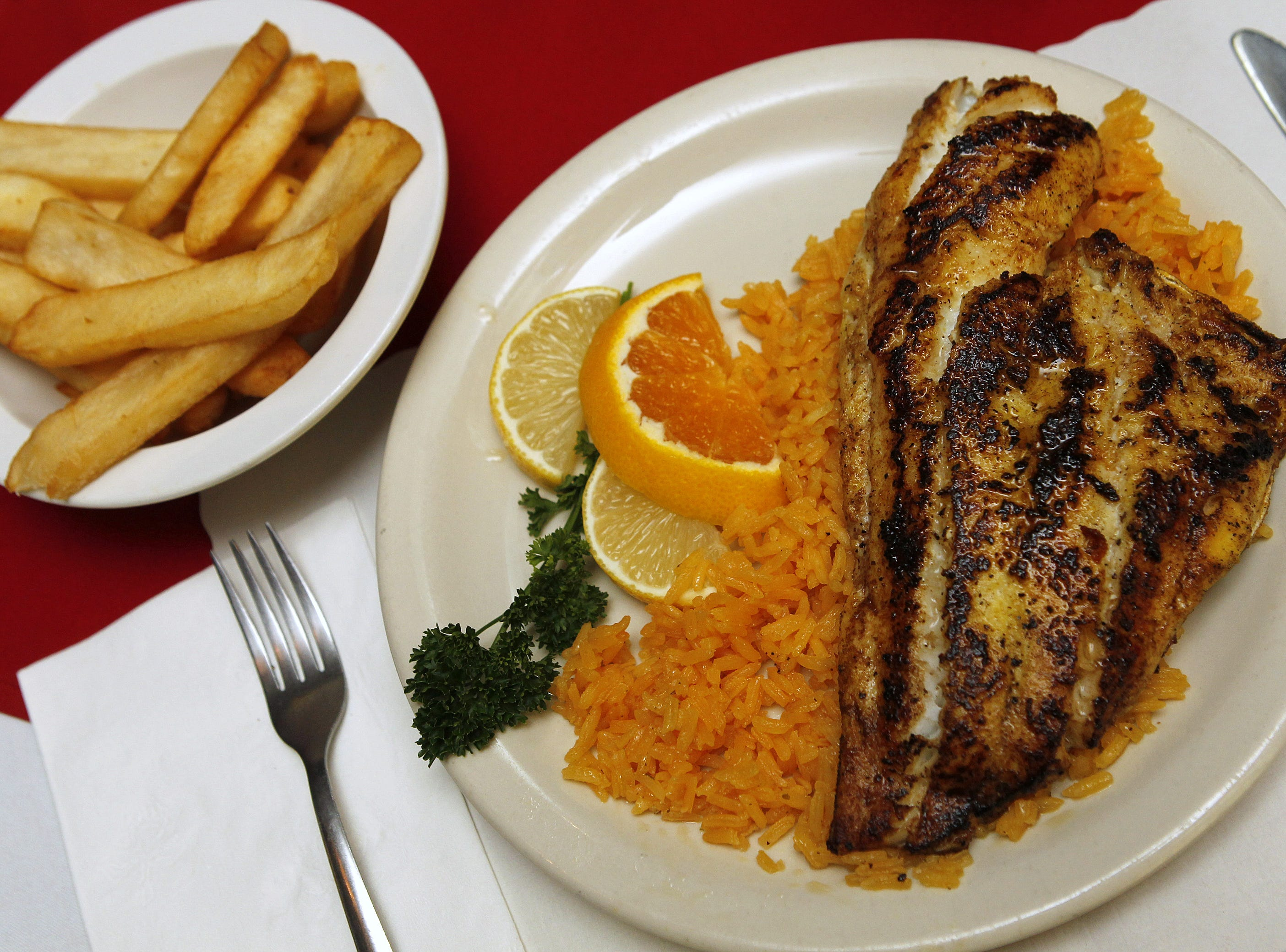 Grilled Haddock over Rice with Fries at The Reunion Inn in Irondequoit in 2010.