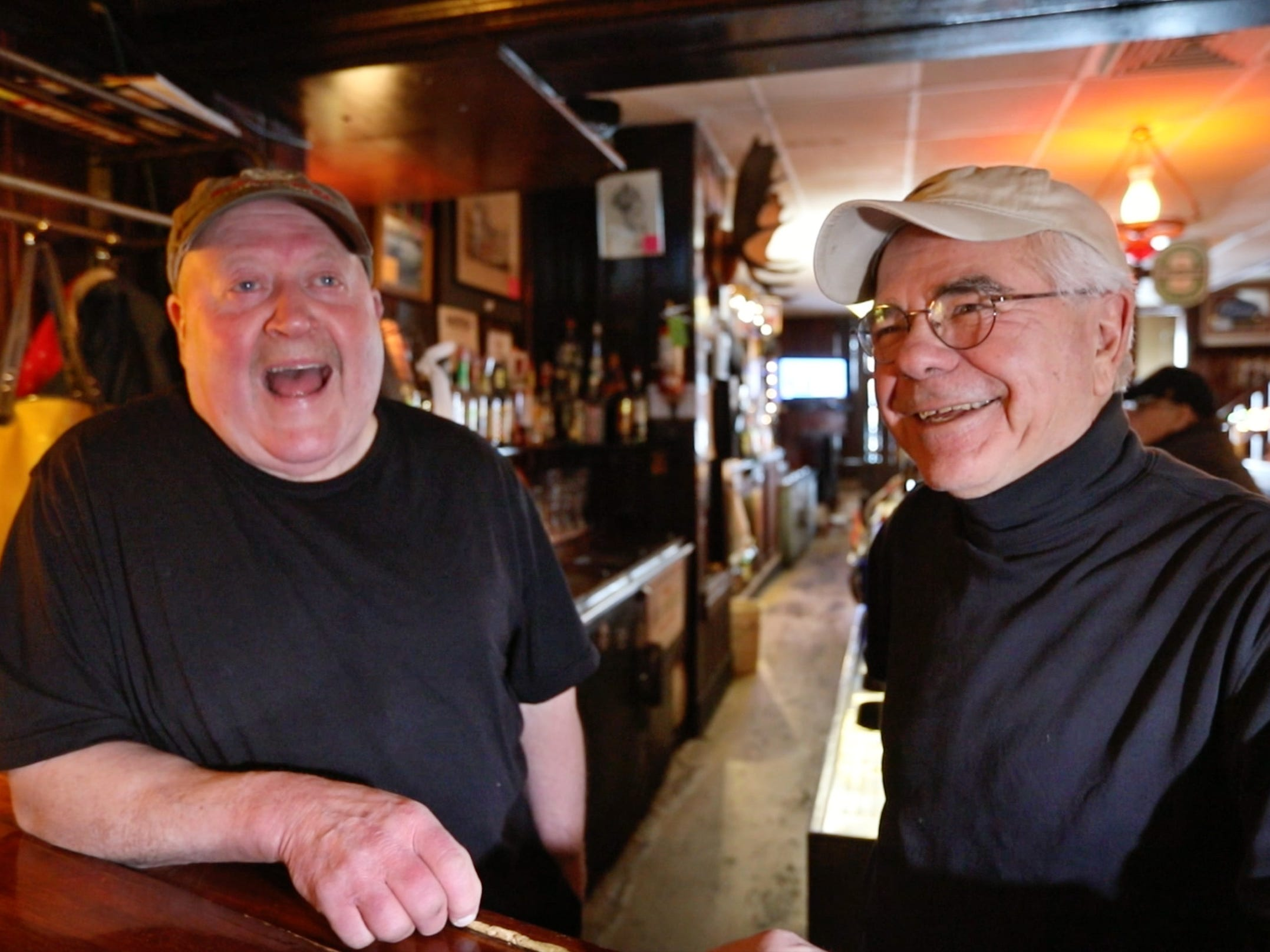 Owners Steve Sahs, left, and Jim Barnash share laughs from behind the bar as they talk about the some favorite memories at their Reunion Inn in Irondequoit Thursday, Jan. 24, 2019.