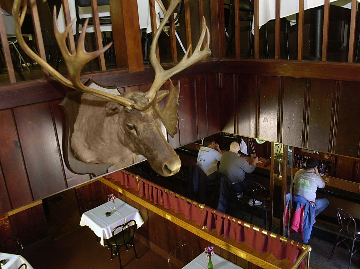 A caribou from Northern Canada faces the entrance at the Reunion Inn across from Seabreeze on Culver Rd, as guests enjoy some beverages in 2002.