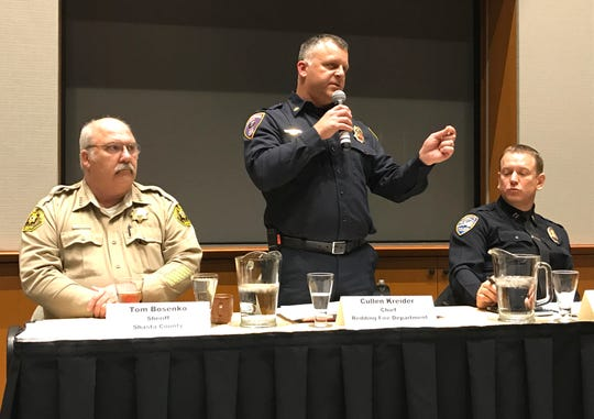 Redding Fire Chief Cullen Kreider, center, speaks to a gathering of the League of Women Voters alongside Shasta County Sheriff Tom Bosenko, left, and Redding police Capt. Bill Schueller, right, on Jan. 23, 2019.