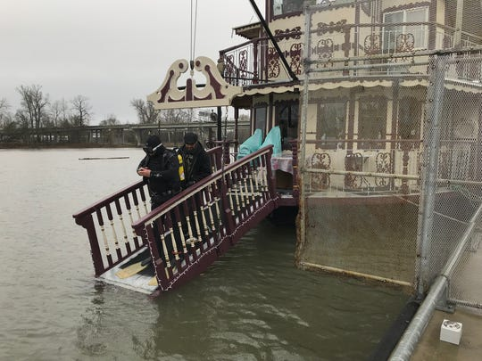 Capt. Richard Chesbrough hired diver Toby Stubbs to seal the crack with a repair putty, but he was unable to complete repairs because of the frigid water temperature, estimated at about 45 degrees on Tuesday, Jan. 22.