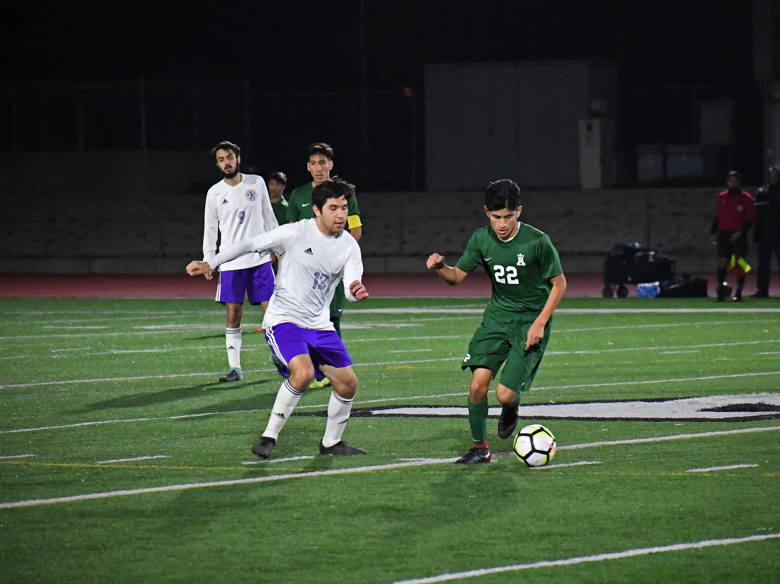 Alisal defender Joel Garcia (22) steals the ball and turns upfield.