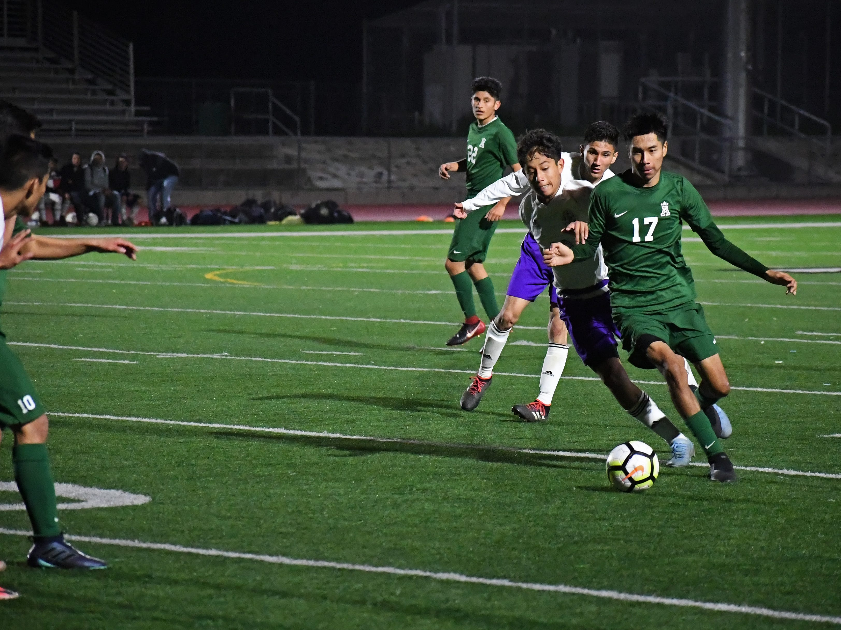 Alisal defender Angel Medrano (17) fights to gain possession back.