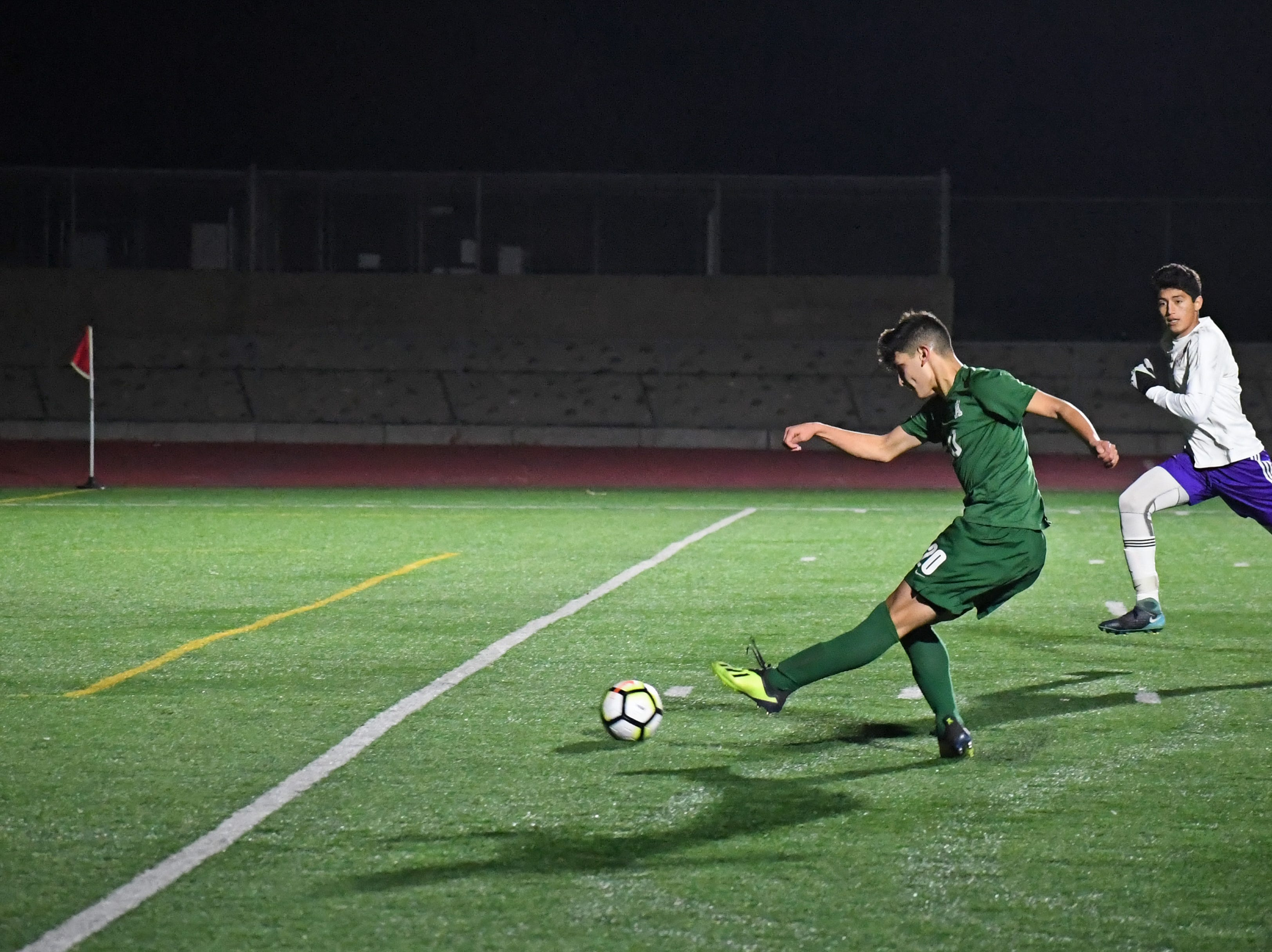 Alisal midfielder Abraham Montaño (20) fires the ball to the far corner of the goal.