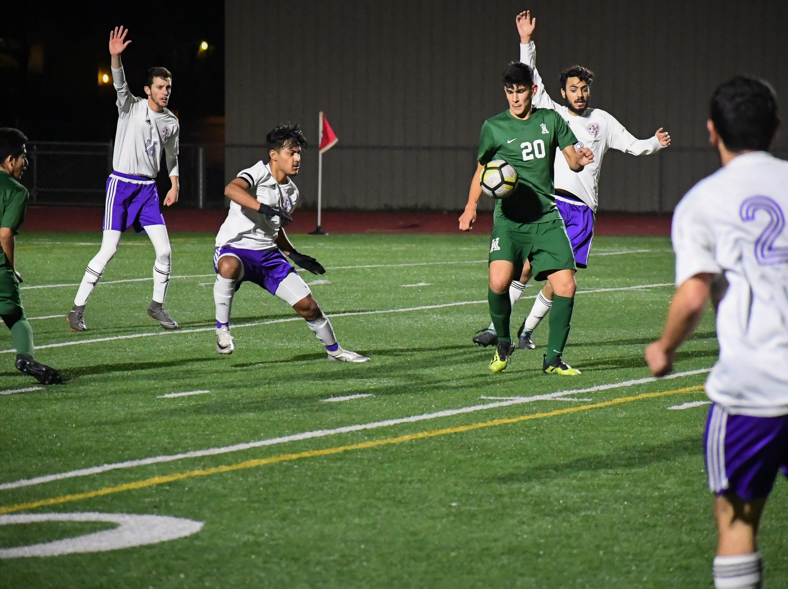 Alisal midfielder Abraham Montaño (20) takes a pass from Julien Peguero and looks to score.