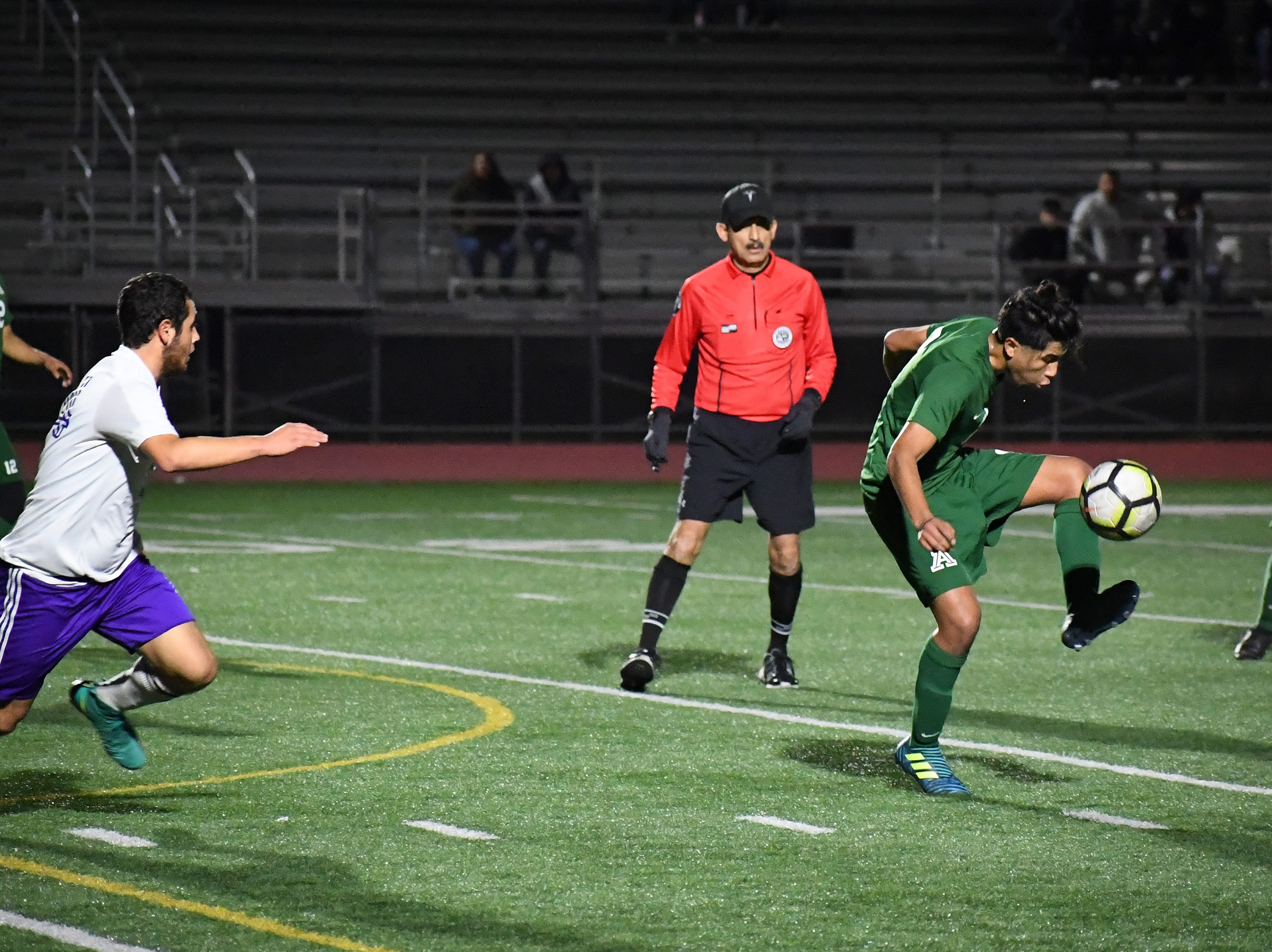 Alisal defender Sergio Mejia (21) knocks a pass to the left.