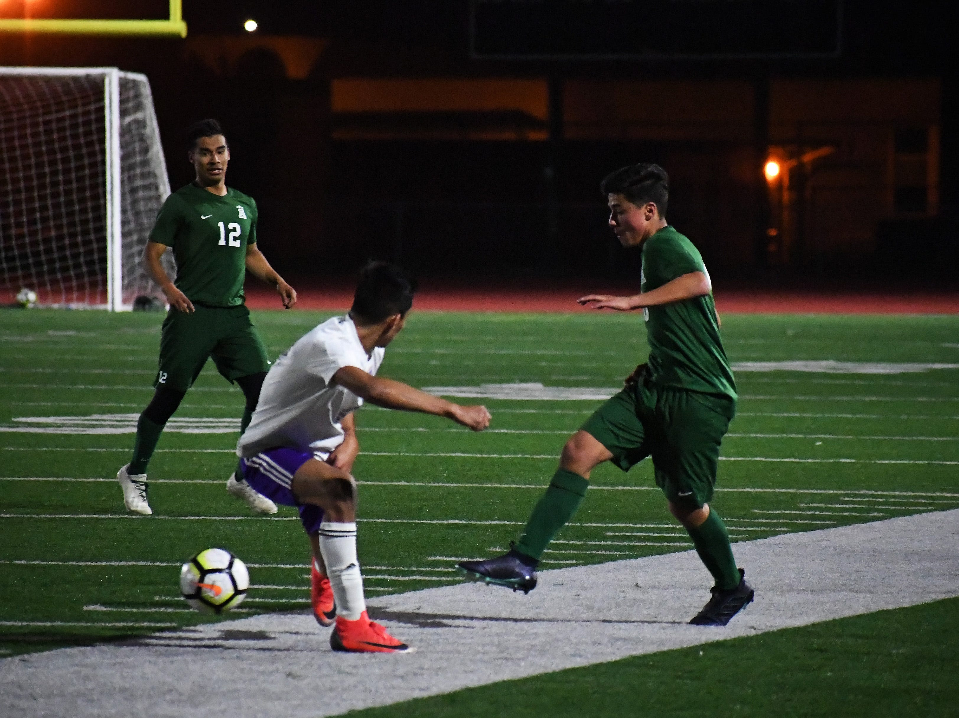 Alisal midfielder Jacob Cabrera (10) passes between the legs of defender.