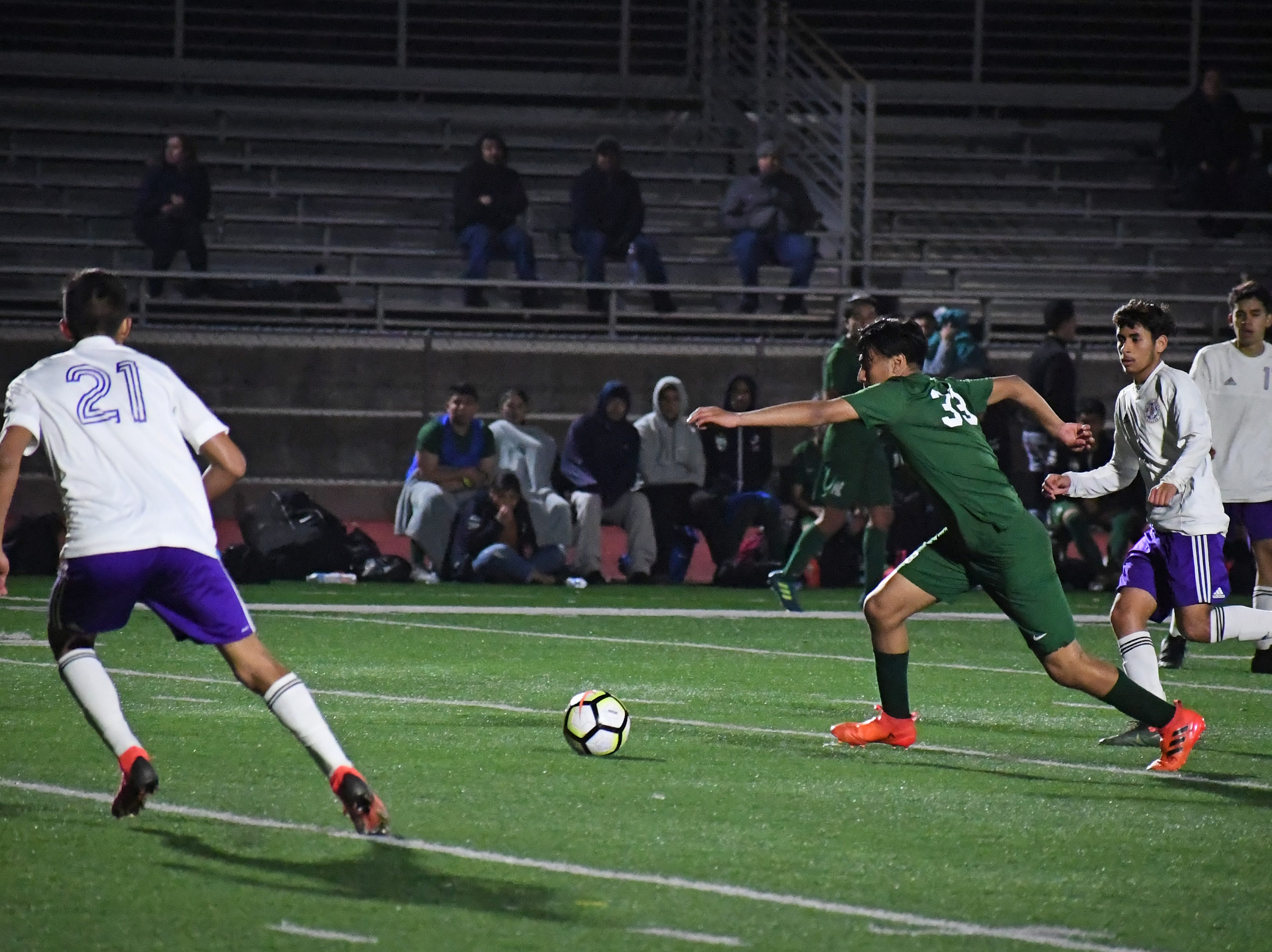 An Alisal forward sprints towards the goal.