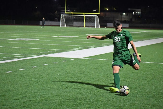 Alisal midfielder Abraham Montaño (20) fires off a free kick in the first half.