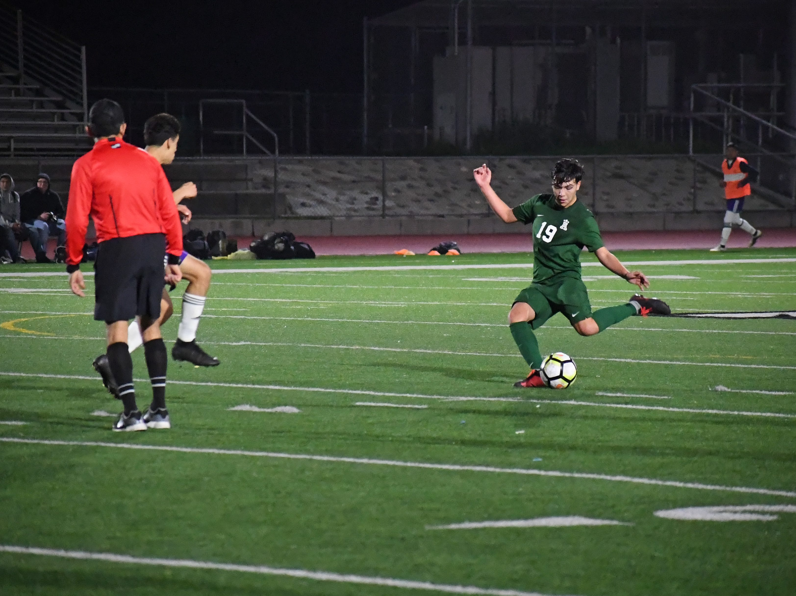 Alisal defender Jose Trujillo (19) readies to pass around a defender.