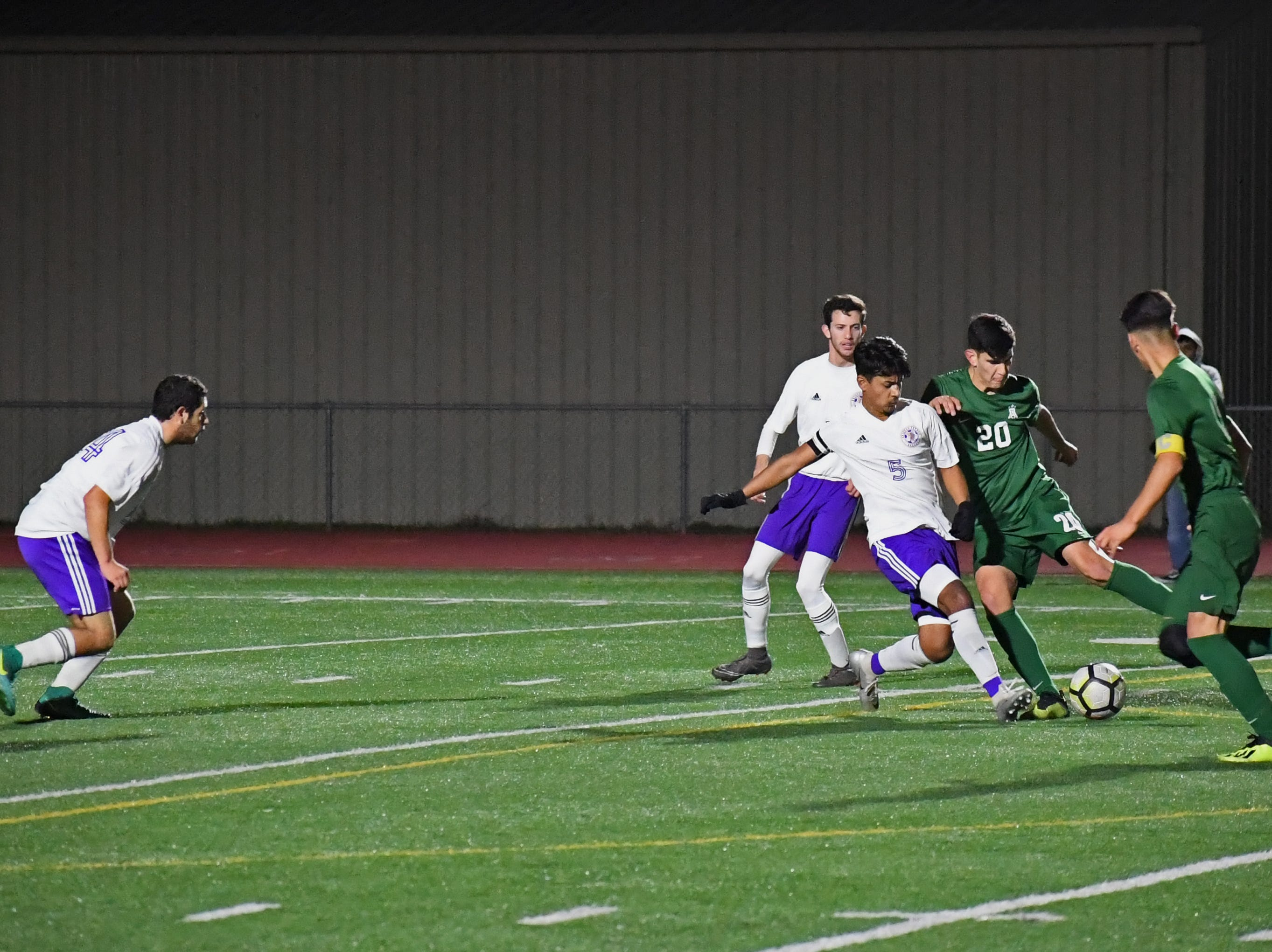 Alisal midfielder Abraham Montaño (20) corrals a cross from the left side.