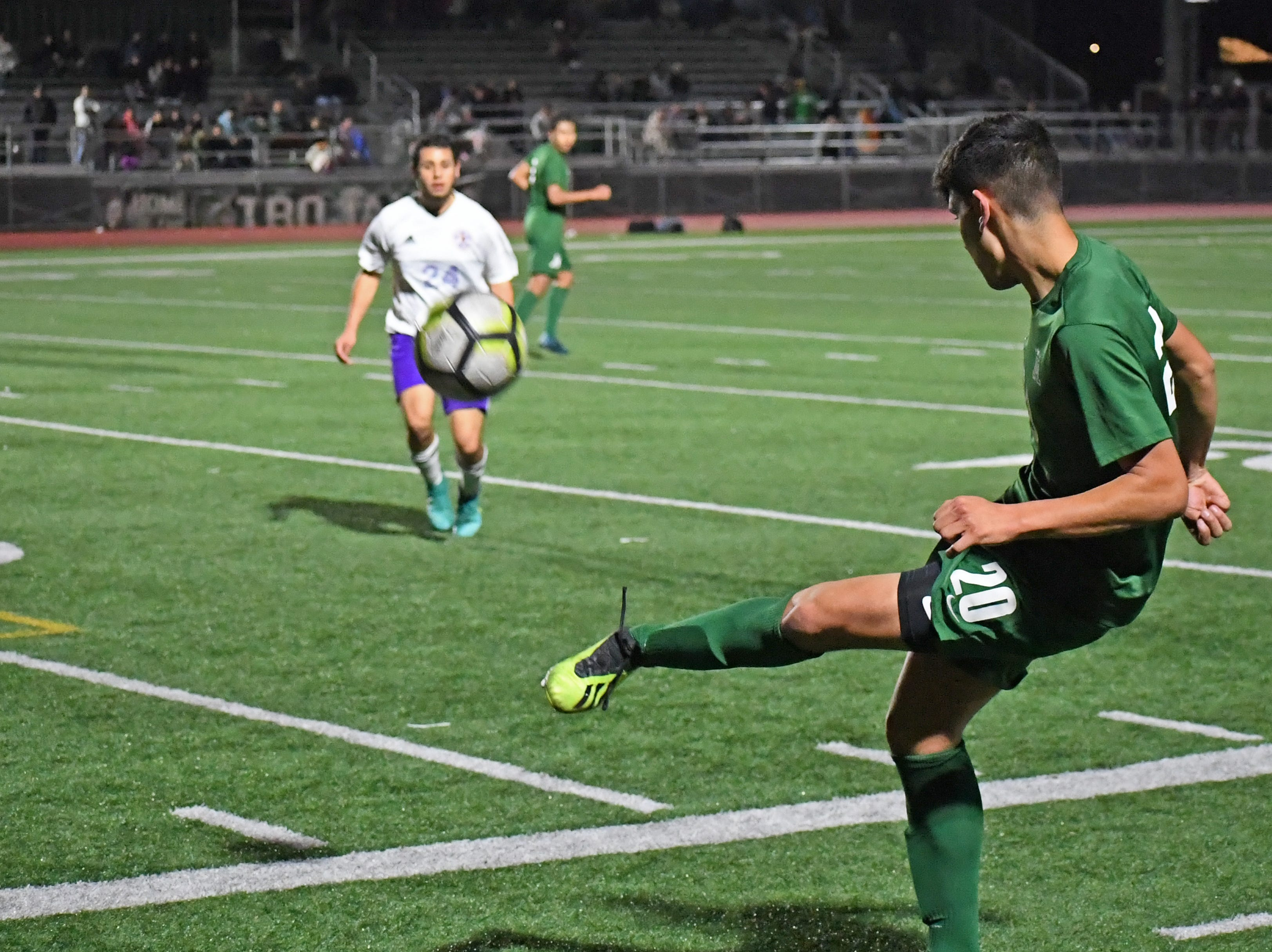 Alisal forward Abraham Montaño (20) kicks a pass towards the front of the box.