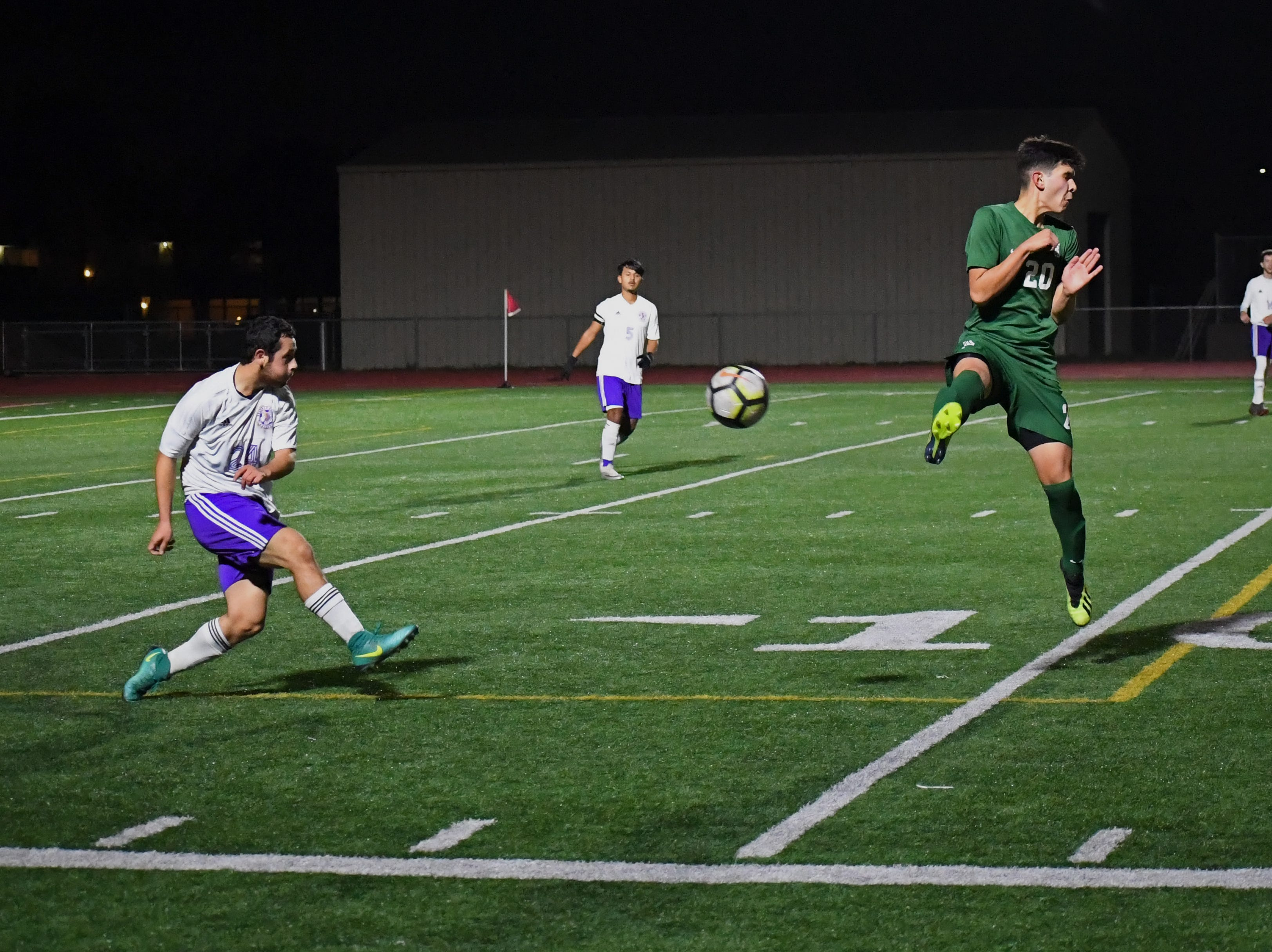 Alisal forward Abraham Montaño (20) braces from blocking a kick.