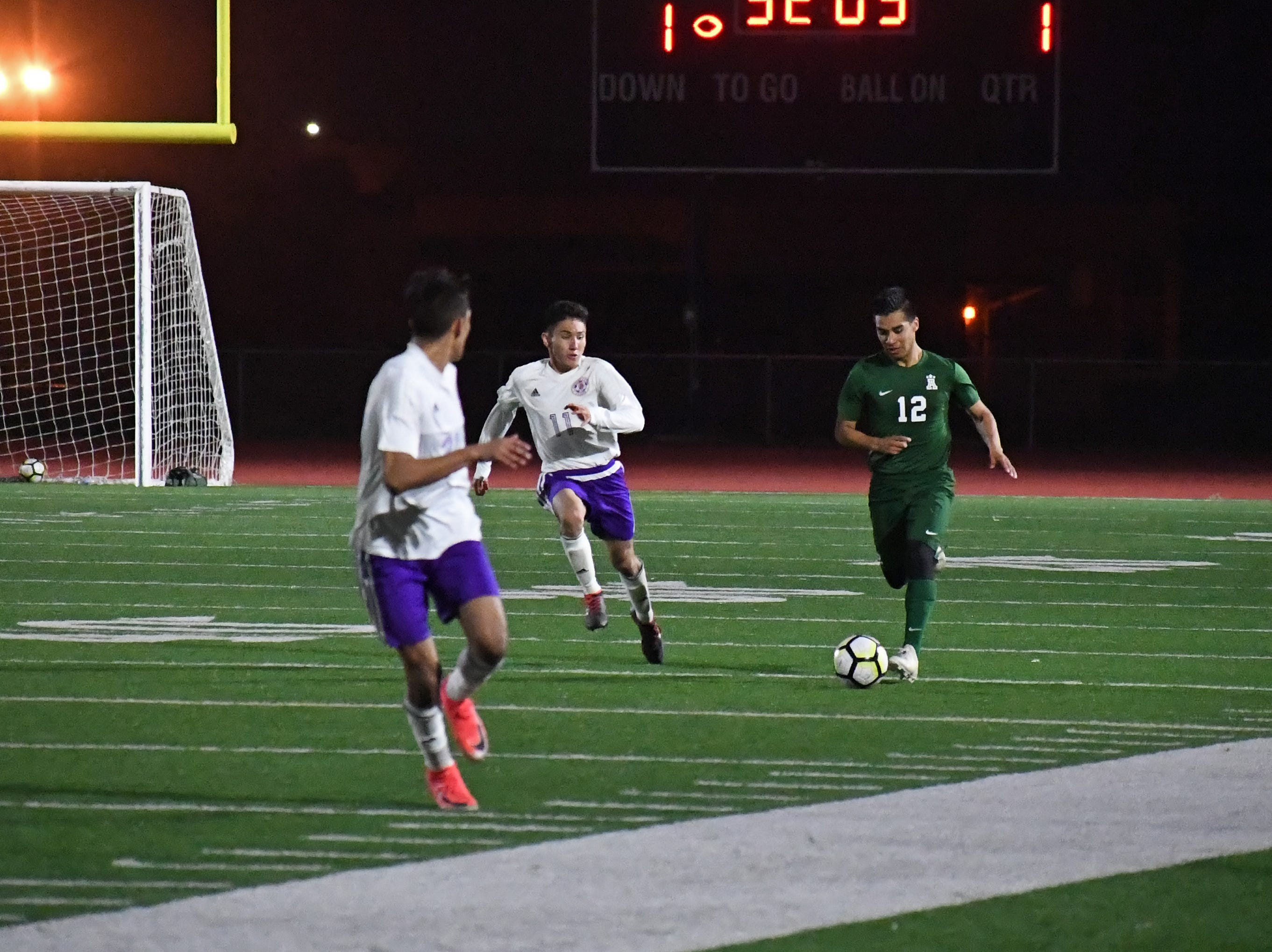 Alisal midfielder Jesus Gregorio (12)  sprints up the left side of the field.