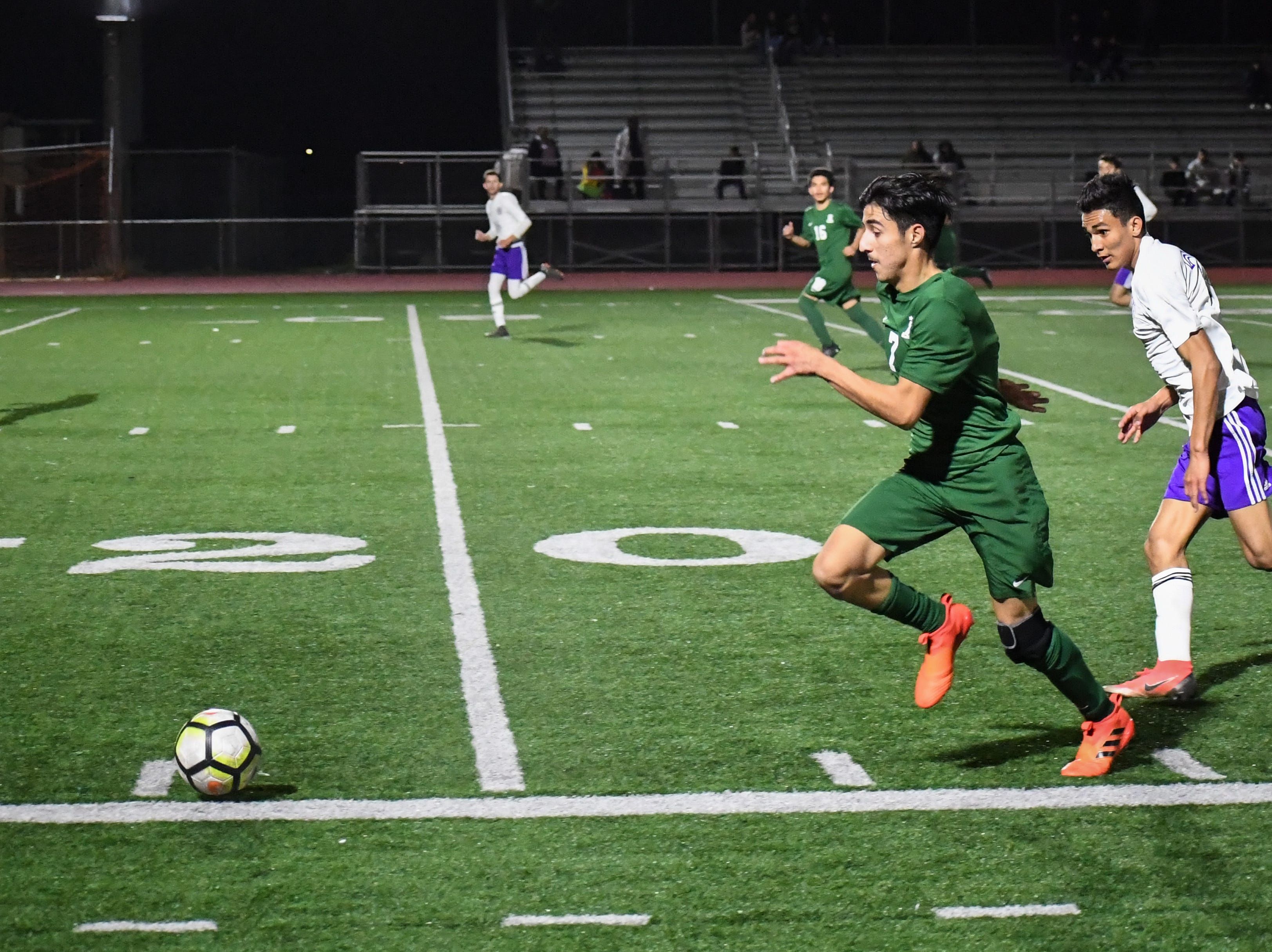 Alisal midfielder Julien Peguero (7) sprints past a defender.