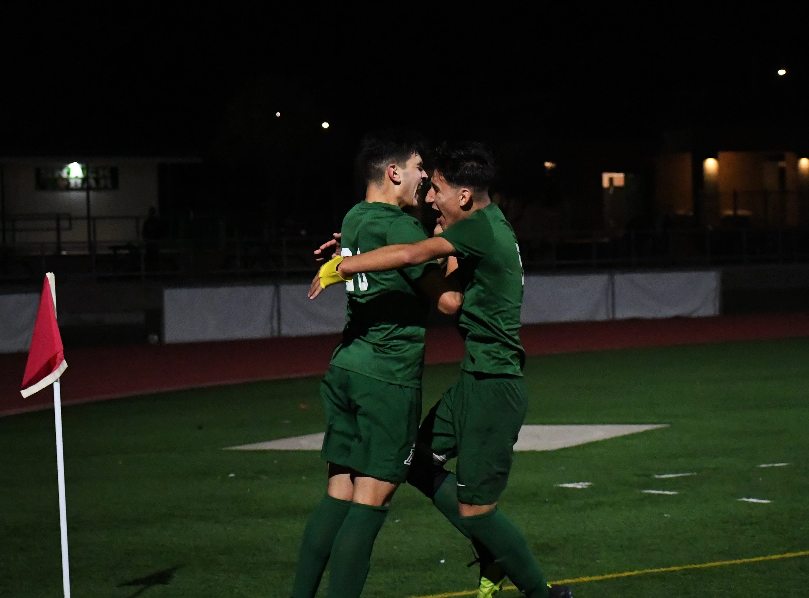 Alisal midfielders Abraham Montaño (20) and Osvaldo Avalos (5) celebrate the former's goal.
