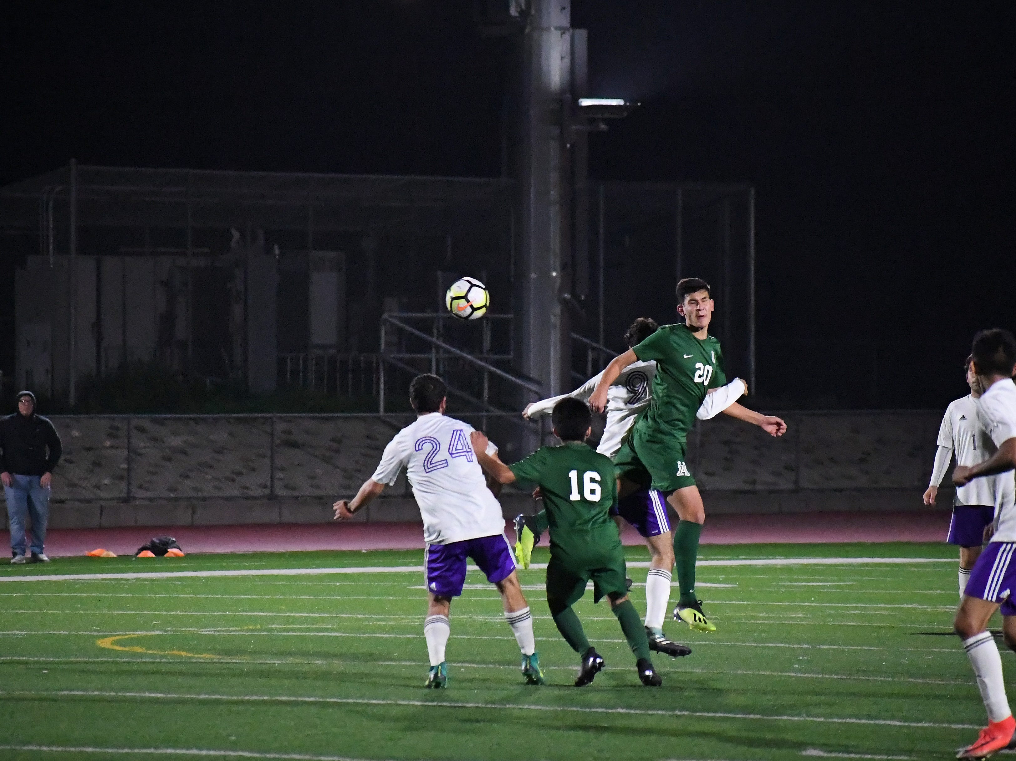 Alisal midfielder Abraham Montaño (20) heads the ball in front of forward Orlando Juarez-Hernandez (16).